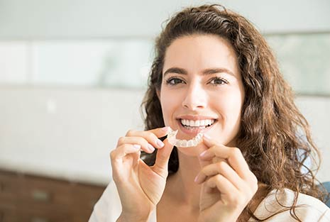 image of a woman showing clear aligners